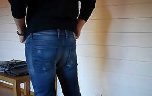 Trying on tight jeans