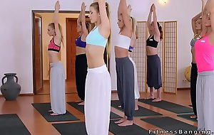 Two babes fucking yoga coach after class