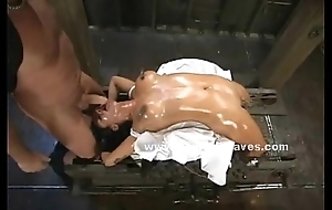 Bitch lying on a machine in bdsm glaze