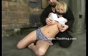 Blonde bitch tied like a hog underground