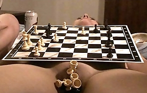 chess match on naked body