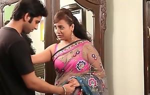 Indian teacher in sexy pink bra and sari seducing youthful guy