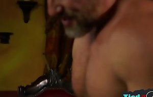 Mature dom flogging muscly submissive