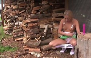 Pretty blonde girl in cute clothes plays with her coochie outdoors