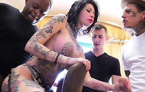 Tattooed bitch with big juggs acquires gangbanged in the living room