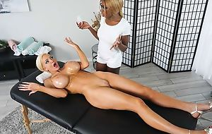 Tall bitch gets seduced and fucked by black masseuse