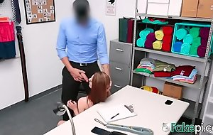Redhead shoplifter babe gets deep penetrated on the desk
