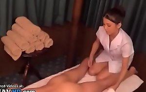 Japanese masseuse in uniform satisfies her client
