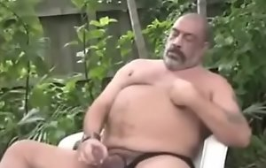 Latino daddy jerks off his big dick