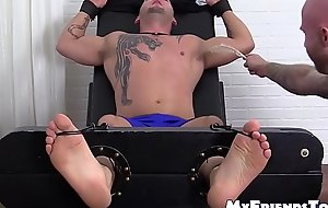 Two dudes torture a tied up jock with smelly sweaty feet
