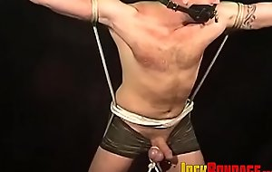 Restricted jock enjoys bondage with his balls tied up too