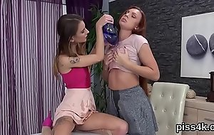 Fervent lesbian teenies get splashed with urine and squirt wet honey pots