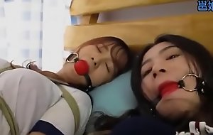 Bound and gagged asian sluts get teased by a dyke