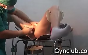 Examination on the gynecological chair of a dildo and a sextoy (04)
