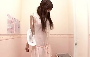 Innocent Japanese housewife trying new brassiere